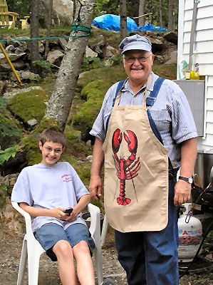 Tony and friend cooking lobsters